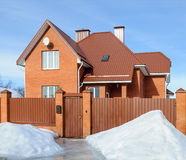 New country brick house in winter Royalty Free Stock Images