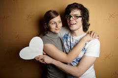 New couple enclosing one another Royalty Free Stock Photo