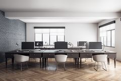 New coworking office interior. With wooden floor and windows with daylight. Workplace and design concept. 3D Rendering royalty free illustration