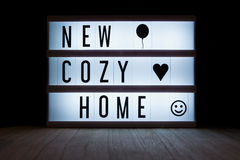 New cozy home. `New cozy home` text in lightbox Stock Image