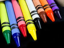 New Crayons. A brand new crayons out of the box, just in time for the new school year stock photos