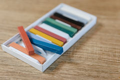 New crayons pastels color in box - back to school, education, arts Royalty Free Stock Photos