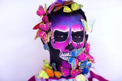 Skull man with butterflies. New creative calavera is a representation of human skull. applied to decorative make up the Mexican celebration of the Day of the royalty free stock image
