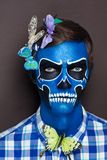 Skull man with butterflies royalty free stock photo
