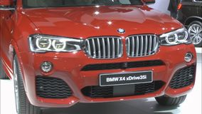 The new crossover BMW X4. MOSCOW, August 28: The new crossover BMW X4 xDrive35i at the International Automobile Salon on August 28.2014 in Moscow stock video footage