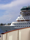 New cruise ship behind deck of vintage cruise ship. New cruise ship seen behind deck of a vintage cruise ship in Nassau, Bahamas Royalty Free Stock Photo
