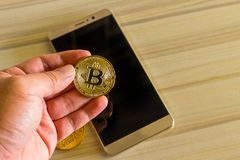 Crypto currency concept.Bitcoins ,Gold Coins ,Cryptocurrency wit. New crypto currency concept.Bitcoins ,Gold Coins ,Cryptocurrency with space for your Concept stock photography
