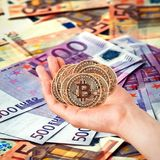 New crypto currency in the form of the coins. Golden Bitcoins. Bitcoin in the hands. Photo new virtual money New crypto currency in the form of the coins royalty free stock image
