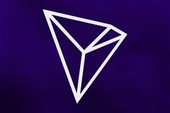 New 2018 cryptocurrency symbol: Tron Coin on ultra violet background. New 2018 cryptocurrency symbol: Tron Coin on the ultra violet background royalty free stock photo