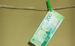 The new currency is two hundred rubles, hanging on a rope royalty free stock photo