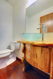 New custom build bathroom with blue modern sink. Custom wood cabinet with blue sink Royalty Free Stock Images