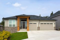 New Custom Built Home in Suburban Neighborhood. New custom built house in Happy Valley Oregon suburban neighborhood with three car garage and manicured front Stock Photo