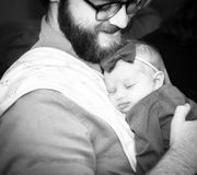 New Dad Holding Infant Daughter While She Sleeps Royalty Free Stock Photography