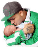 New Dad with Son. A young Hispanic dad loving on his newborn son. Isolated on white Royalty Free Stock Images