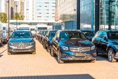 New dark Mercedes-Benz cars parked in the car dealership. Russia, Saint-Petersburg. July 12, 2017. New dark Mercedes-Benz cars parked in the car dealership Royalty Free Stock Images