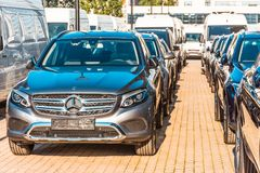New dark Mercedes-Benz cars parked in the car dealership. Russia, Saint-Petersburg. July 12, 2017. New dark Mercedes-Benz cars parked in the car dealership Stock Images