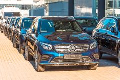 New dark Mercedes-Benz cars parked in the car dealership. Russia, Saint-Petersburg. July 12, 2017. New dark Mercedes-Benz cars parked in the car dealership Stock Photography