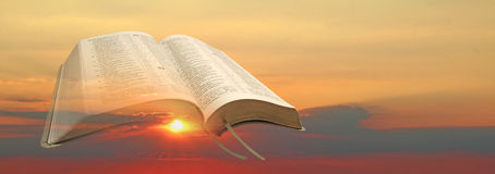 New dawn bible. Photo of open bible set against new dawn rising sun royalty free stock images