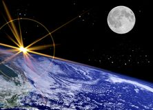 A New Day. Atmospheric star studded Background with Moon and Sunburst on Earths surface Stock Photo