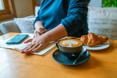 New day with coffee and croissant royalty free stock photography