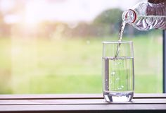 New day with glass of water. Space for text stock photography