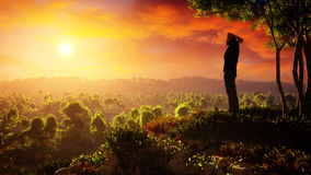A New Day Of Hope Rises. A man on top of a hill feeling the hope, strong will and motivation while gazing at the rising sun. A new day of hope rises Stock Image