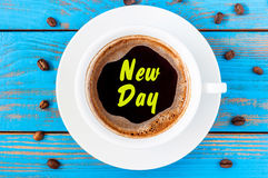 New Day - inscription on morning mug of coffee or espresso. Motivate concept Royalty Free Stock Photography