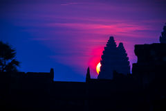 New day in an old place. Sunrise at Ankor Wat, an ancient historic civilization area that is in ruins now. silhouette stock photography
