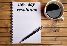 New day resolution word. On notepad Royalty Free Stock Photos