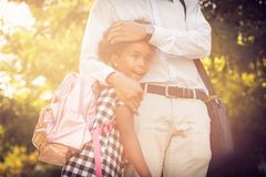 New day for work and school. African American father and his daughter walking trough park royalty free stock images