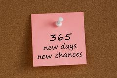 365 new days new chances written on remember note. With pin on cork board Stock Image