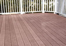 New Deck. Made of composite planks and white vinyl rails Stock Image