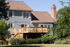 New deck on suburban home. New wood deck on back of suburban house stock images