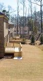 New Decks on Brick Homes. Treated lumber decks on new brick homes in winter Stock Photo