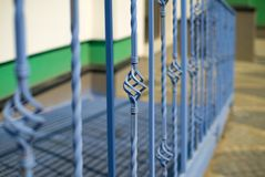 New decorative iron wrought fence with artistic forging. Metal railing close up Stock Photos