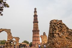 New Delhi, India - February 2019. Qutub Minar minaret at the Qutb complex. At 72.5 meters 237.8 ft the Qutb Minar is the tallest stock photography