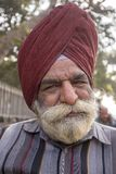 Portrait indian poor man. New Delhi, India. NEW DELHI, INDIA - JANUARY 23, 2017 : Indian poor man came to see preparations for the India Day parade in New Delhi royalty free stock photos
