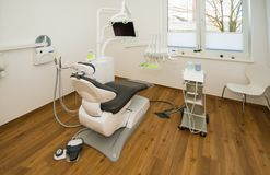 new dentist`s chair is placed in the dentist`s treatment room stock photo