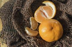 New design. Christmas design. In sacking tangerines lie on a table. New design. Christmas design. In sacking tangerines Royalty Free Stock Image