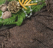 New design. Christmas design. On the table lay sacking tangerines, berries, branch of pine or spruce cones. Blank space for writin. G, advertising Stock Image