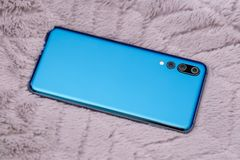 New design smartphone. Looks like Huawei P20 pro stock images