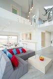 New, designed house with grey sofa stock photo