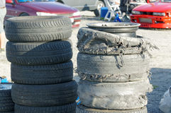 New and destroyed tires and burnt tire tread on car drifting Royalty Free Stock Photography