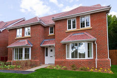 New detached brick built house. Photo of a brand new unoccupied detached red brick built five bedroom house on a modern housing development Stock Image