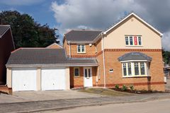 New Detached House For Sale. New detached brick house with a double garage with for sale signs Stock Photos