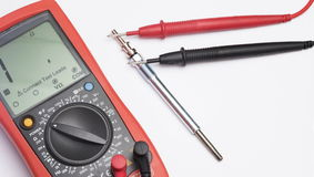 New diesel engine glow plug and multimeter Stock Image