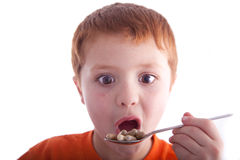 New Diet. Young boy trying out a new health diet with vitamins, supplements Royalty Free Stock Image