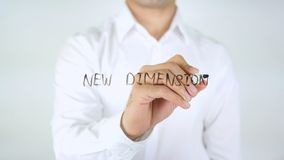 New Dimension, Man Writing on Glass. High quality royalty free stock image