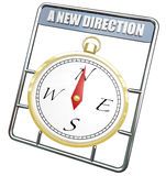 A New Direction Compass Change Course Lead to Success. A New Direction words on gold compass to symbolize change and evolving to direct to a new course to lead Royalty Free Stock Images