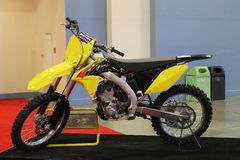 New dirt motorbike. New yellow Suzuki sports dirt motorbike on display at show Stock Photo